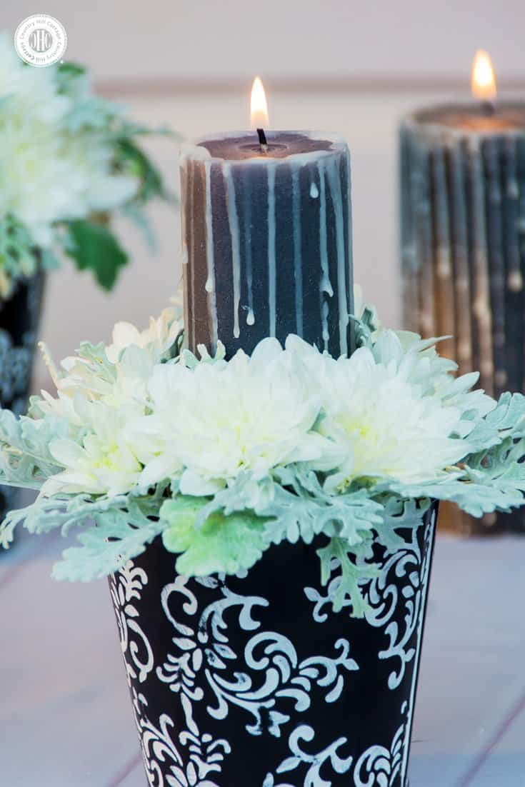 Learn to create Halloween flower pots with white chrysanthemum, silver dusty miller and a drip candle! #Halloween #flowerarranging | countryhillcottage.com