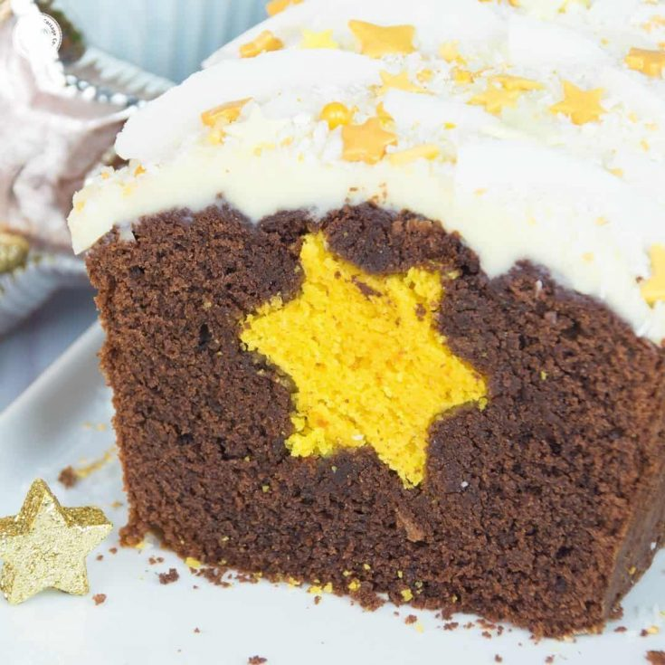 Our chocolate star surprise inside cake is made of yellow pound cake baked into a moist chocolate batter and topped with cream cheese icing | countryhillcottage.com