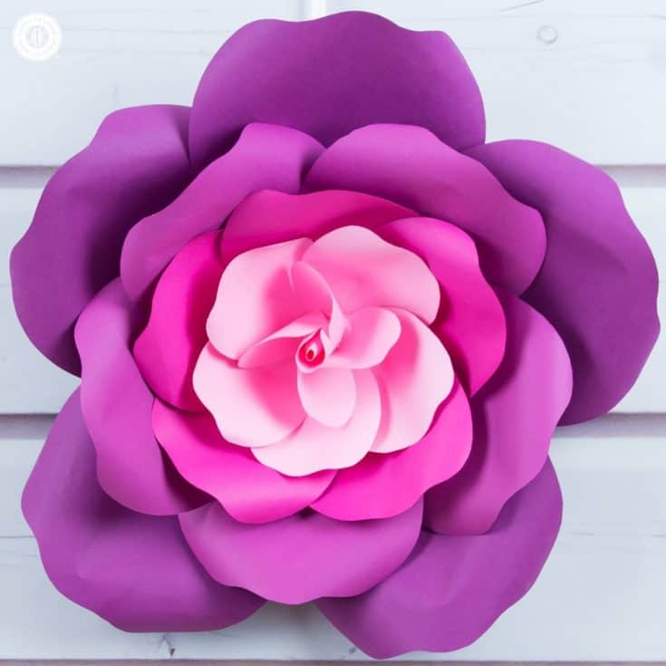 Learn to craft giant paper roses and get a free printable template for the petals. The giant paper flowers are perfect for romantic flower photo backdrops for parties and weddings, nurseries, girl's rooms, and a single rose looks great as a wall ornament. This quick paper craft tutorial shows easy step-by-step instructions for paper roses. Download the large paper rose flower template for making the petals at our blog. #paperrose #papercrafts #paperflowers #freetemplate   countryhillcottage.com