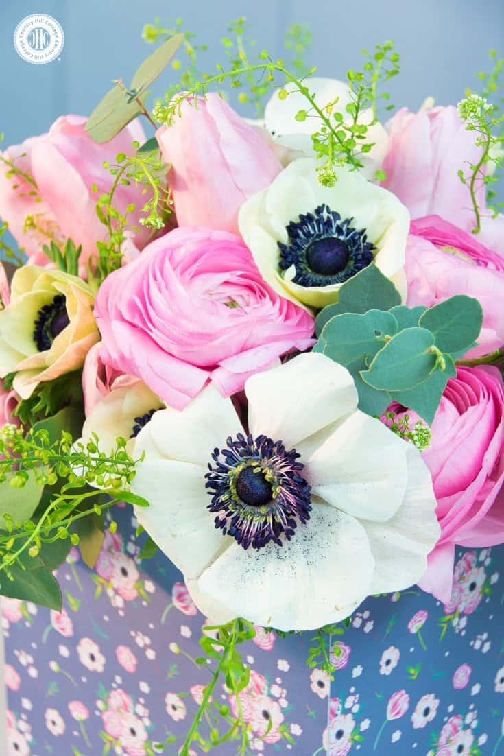 Learn to create a beautiful spring flower arrangement with ranunculus, anemones and tulips inspired by our Osterley at Park design. #flowerarranging #homedecor | countryhillcottage.com
