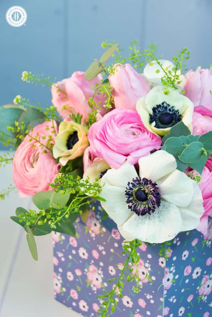Learn to create a beautiful spring flower arrangement with ranunculus, anemones and tulips inspired by our Osterley at Park design. #flowerarranging #homedecor   countryhillcottage.com