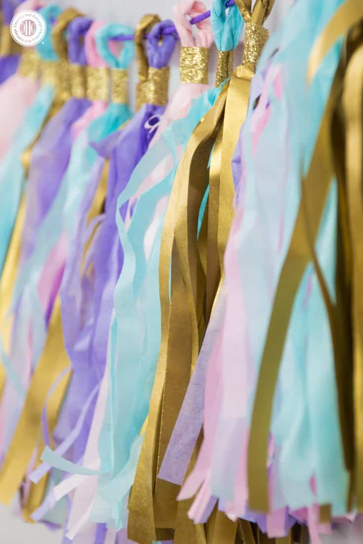 Learn to craft a beautiful tassel garland in 4 easy steps made from tissue paper. This garland looks great as decoration for parties, wedding receptions, and dessert tables. #papercrafts #tissuepaper #paperdecor | countryhillcottage.com