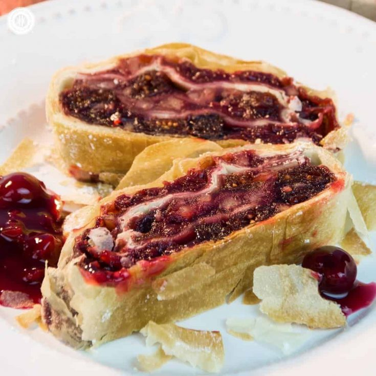 Warm cherry strudel stuffed with cranberries and almonds is a classic dessert and tastes delicious with whipped cream and ice cream! #cherry #strudel #dessert   countryhillcottage.com