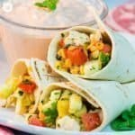 Our chicken lentil tortilla wraps are a great make ahead party snack idea! The filling tastes hearty from the chicken and lentils, fresh and summery from peppers, parsley and lemon juice, and a little spicy from the Tabasco. #chicken #tortilla #partyfood   countryhillcottage.com