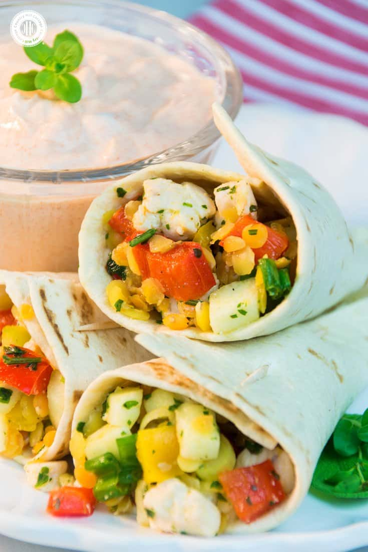 Our chicken lentil tortilla wraps are a great make ahead party snack idea! The filling tastes hearty from the chicken and lentils, fresh and summery from peppers, parsley and lemon juice, and a little spicy from the Tabasco. #chicken #tortilla #partyfood | countryhillcottage.com
