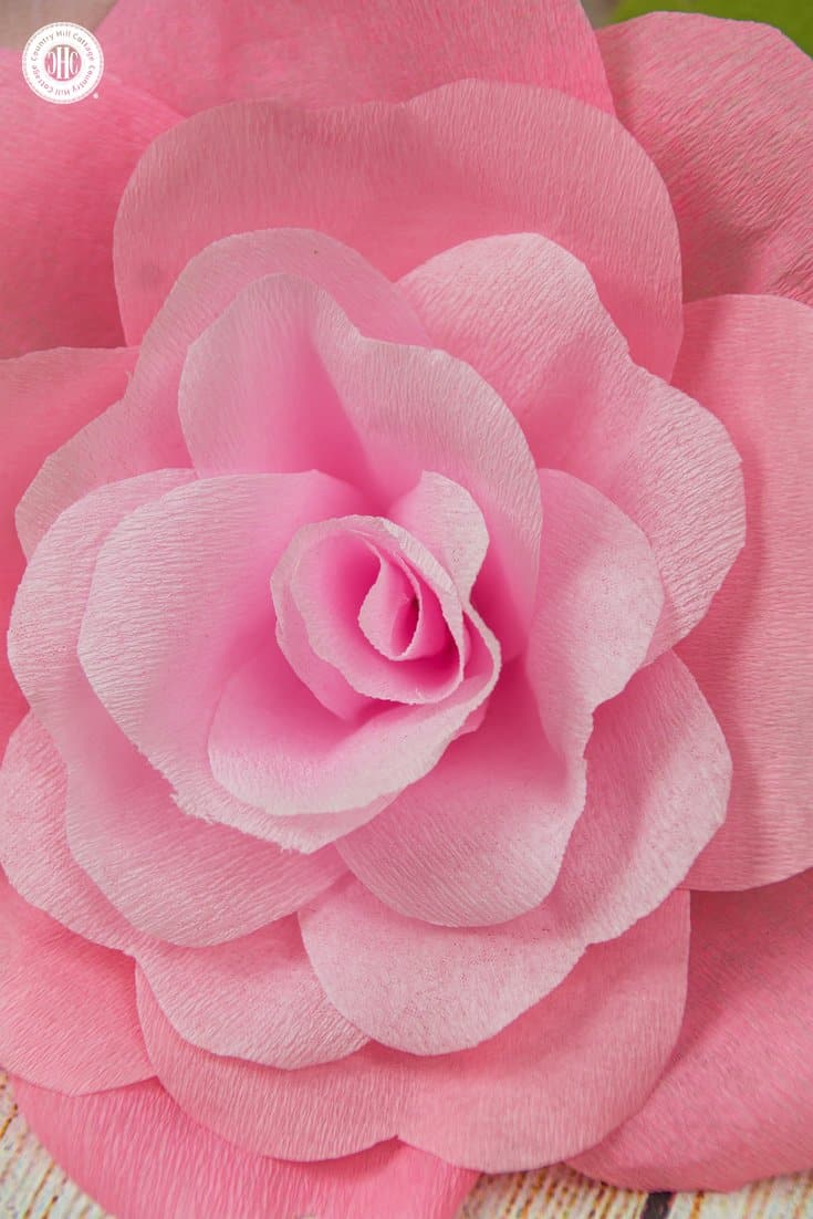 Learn how to make romantic crepe paper roses. These handcrafted beauties are very long lasting and wonderful for home decorating, in paper flower arrangements and wedding decor. We created a printable template to make cutting the petals and leaves as easy as possible. #diy #paperflowers #crepepaper #paperroses| countryhillcottage.com