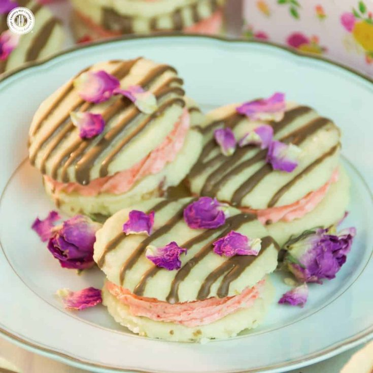 Our strawberry rose meltaways have a delicate, melt-in-your mouth texture. These biscuits are made with dried rose petals, and filled with an airy strawberry and rosewater buttercream. #strawberry #rose #cookies   countryhillcottage.com