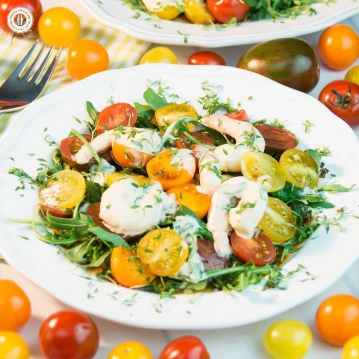 Make the most of vibrant summer produce with this flavour-packed tomato arugula salad with shrimp! Serve the salad as a side for BBQ, a starter as part of dinner or as a light meal. #tomatoes #arugula #salad   countryhillcottage.com