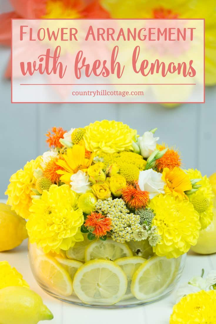 Learn to make a stunning yellow centrepiece with lemons! The focus of the arrangement is all about the texture of the different florals that include dahlias, lisianthus, yarrow flowers, safflowers and billy balls. #flowerarrangement #lemons #centerpiece | countryhillcottage.com