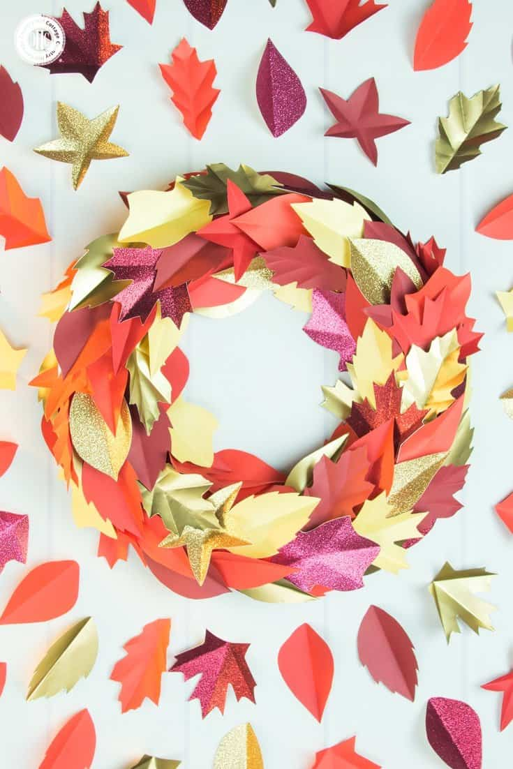 Add autumn style to your home with a gorgeous red and gold autumn paper leaf wreath! Use our printable PDF and SVG templates that includes eight different shapes and numerous sizes to create the leaves. | countryhillcottage.com