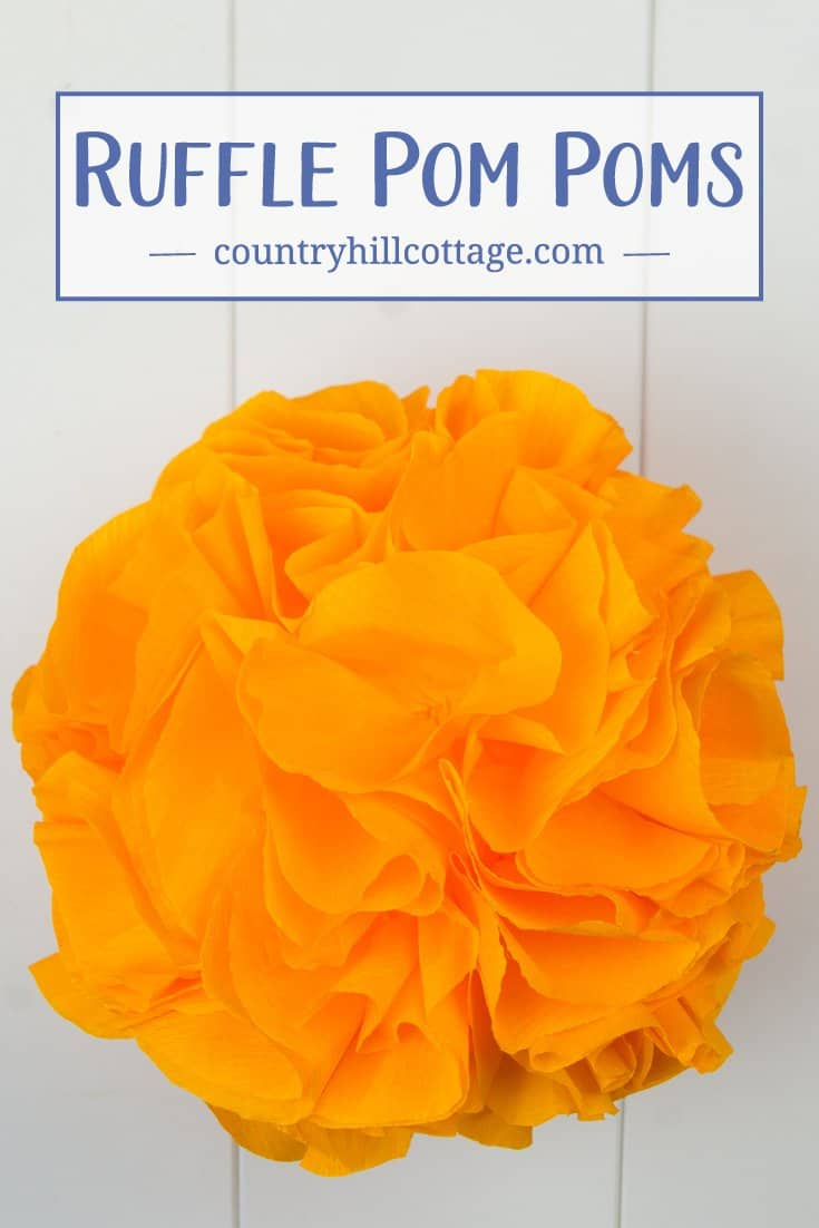 Learn how to make beautiful ruffle pom poms in this quick and easy DIY! You can make the pom poms with crepe paper, tissue paper, or fabric. Ruffle pom poms look very fluffy and elegant and are a great decoration for weddings, showers, parties and home décor.|countryhillcottage.com