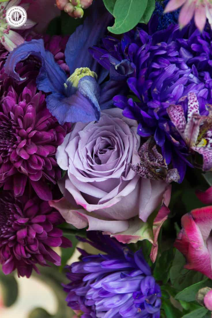 Purple autumn flower arrangement country hill cottage create an opulent purple autumn flower arrangement with roses chrysanthemum asters and clematis izmirmasajfo Choice Image