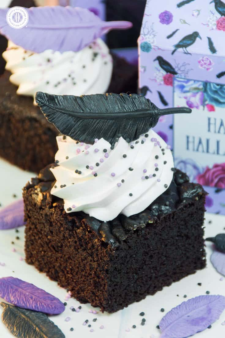 Our raven cake bites are made with rich and moist chocolate cake. Fluffy white buttercream rounds out the deep cocoa flavour, while edible feathers and sprinkles add a spooky yet elegant touch. The cake bites are a yummy treat for Halloween parties and also make a great homemade gift to share with family and friends. #chocolatecake #cake #Halloween | countryhillcottage.com