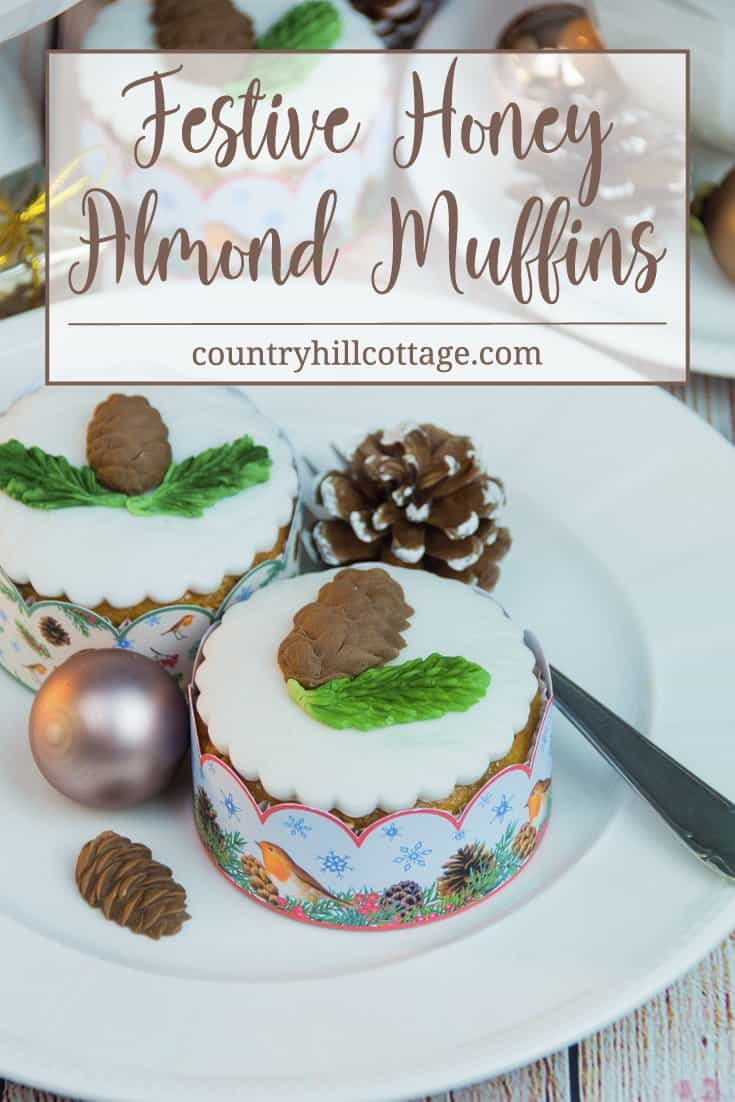 Indulge in Christmas flavours with our delicious honey almond cupcakes! The cupcakes are made with honey-roasted almonds, a generous pinch of cinnamon, and cream cheese to keep them moist. We decorate the cupcakes with edible pine cones and spruce branches. #Christmas #cupcakes #recipe | countryhillcottage.com