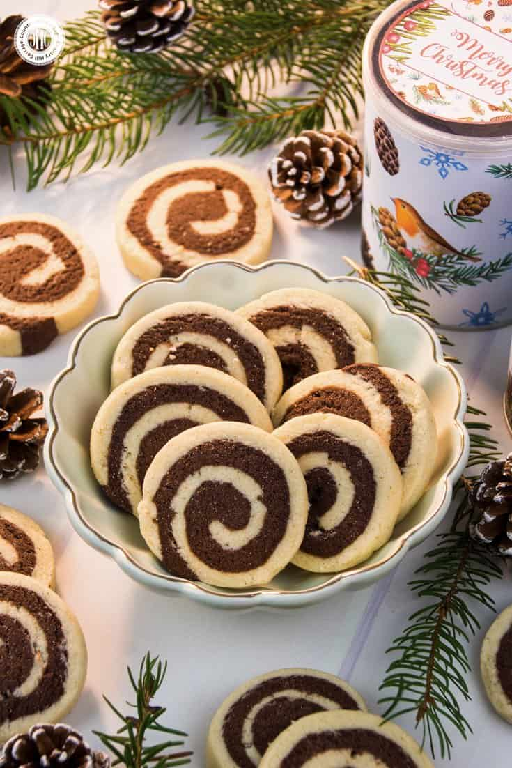 Get our recipe for delicious vanilla and chocolate swirl cookies! The cookies are made with yummy vanilla and sugar cookie dough and we show an effortless way to create the pretty swirl design. #chocolatecookie #cookies #recipe | countryhillcottage.com