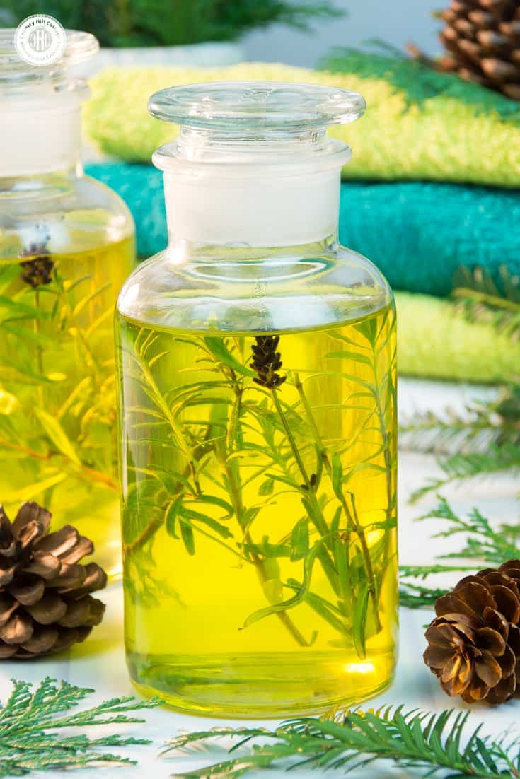 Soothe away the cares of the day with a relaxing bath oil that evokes the feeling of a refreshing walk through the forest. In honour of winter, we used pine, cedarwood and spruce essential oils, which give this bath oil a warm and woody aroma. We chose lavender essential oil to round out the scent because of its calming qualities. #skincare #bathoil #essentialoils #beautydiy | countryhillcottage.com
