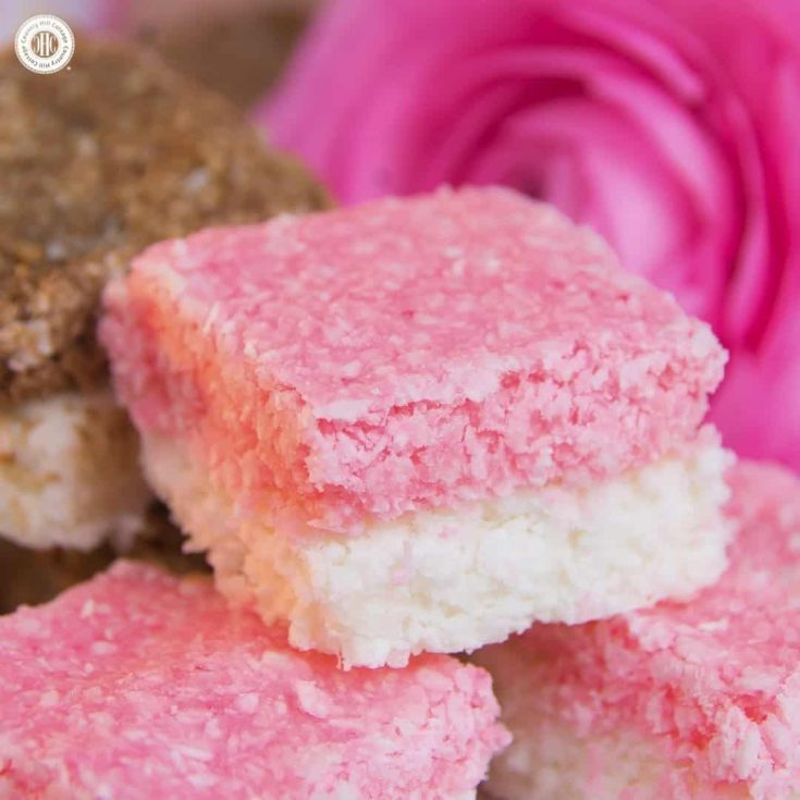 Homemade coconut ice is a sweet and easy-to-do treat, and great as wedding favours or gift for Valentine's Day. This classic British confection is made with desiccated coconut and sweetened condensed milk and has a soft and chewy texture. This recipe only requires mixing and chilling the ingredients, plus we share a chocolate version. #coconutice #candy #foodgift   countryhillcottage.com