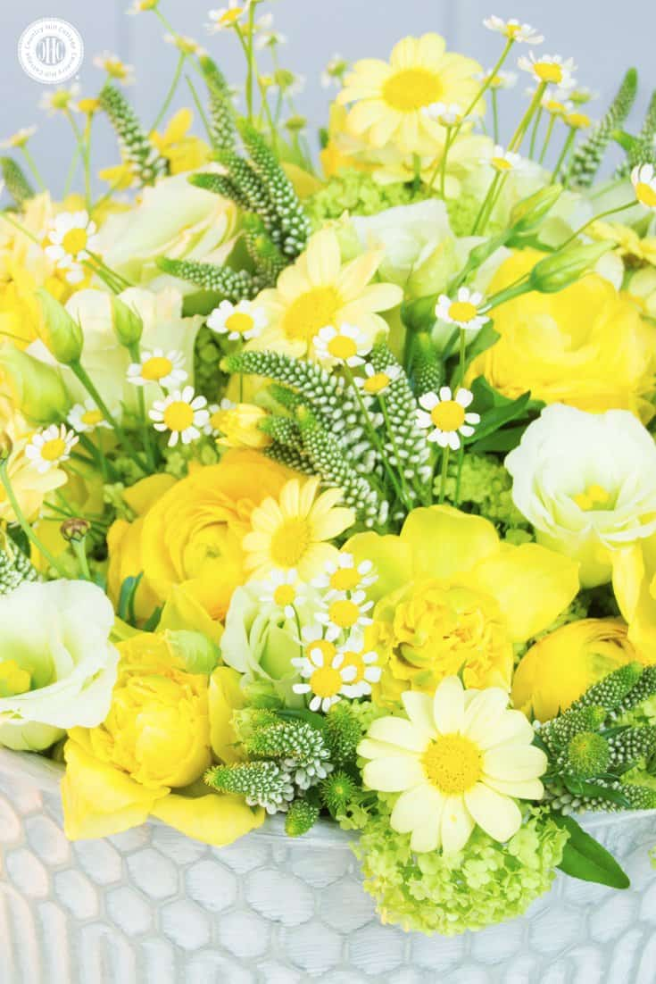 We created this luscious wedding centrepiece with florals from the Spring at Sizergh collection. It's perfect to add springtime sunshine to your special event. #wedding #centerpiece #flowerarrangement #spring   countryhillcottage.com