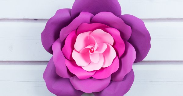 Learn to craft giant paper roses and get a free printable template for the petals. The giant paper flowers are perfect for romantic flower photo backdrops for parties and weddings, nurseries, girl's rooms, and a single rose looks great as a wall ornament. This quick paper craft tutorial shows easy step-by-step instructions for paper roses. Download the large paper rose flower template for making the petals at our blog. #paperrose #papercrafts #paperflowers #freetemplate | countryhillcottage.com