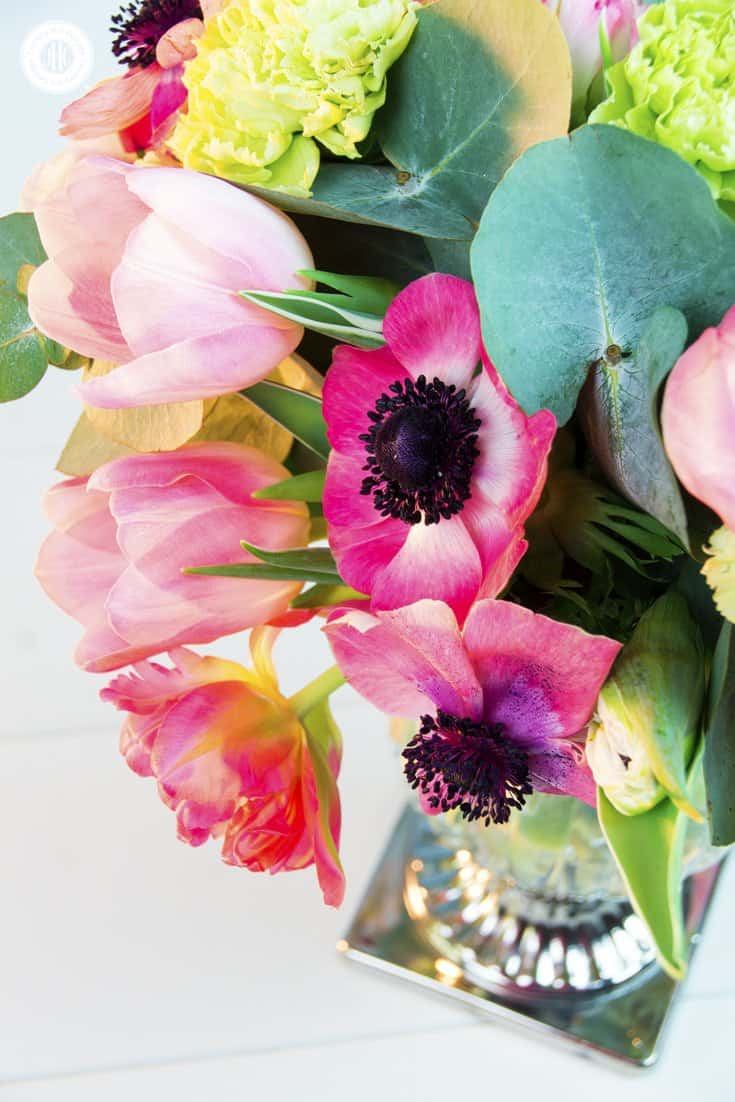 Bring on the spring blooms and create a fast and fresh spring bouquet with our seasonal favourites! The florals include French tulips, parrot tulips and anemones in pink and blush, which we paired with light green carnations and beautiful silver dollar eucalyptus. We used a tall vintage vase with a flared opening on a silver pedestal. #spring #bouquet #tulip #anemone #eucalyptus| countryhillcottage.com
