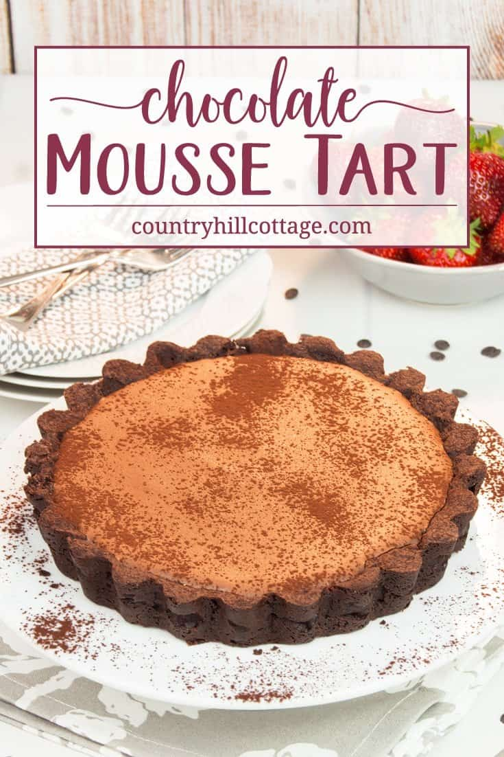 This delicious chocolate mousse tart will satisfy any and every chocolate craving! The chocolate mousse filling is easy enough to whip up and tastes very velvety and rich. The chocolate crust has a deep chocolate aroma and tender texture. The chocolate mousse tart is a wonderful way to finish an elegant dinner. You can serve the tart with whipped cream, a scoop of vanilla ice cream, and fruits. #chocolate #chocolatemousse #tart #pie #dessert #recipe | countryhillcottage.com