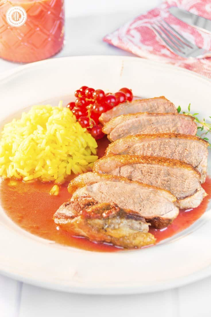 Honeyed, pan-seared duck breast with redcurrant sauce is a mouthwatering main course. Duck is a welcome alternative to chicken or turkey. The meat is a little darker than the later and has a richer flavour. The redcurrant sauce, which tastes sweet and a little tart, is cooked with fresh berries, thyme and cognac. This is a nice dish to serve at a fancy dinner party or holiday feast and doesn't take much time to prepare. #duck #redcurrants #dinner #recipe | countryhillcottage.com