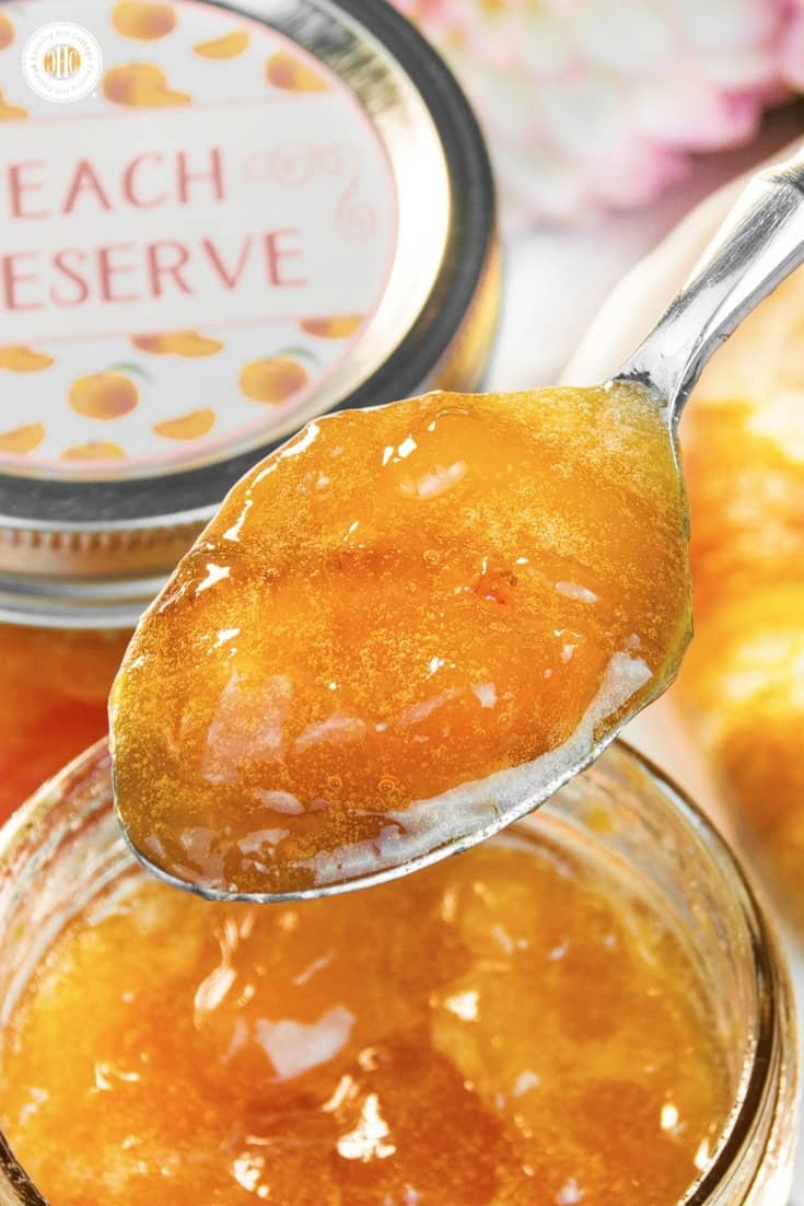 Delicious peach preserves are syrupy and soft-set with juicy peach chunks throughout. This homemade peach jam tastes scrumptious slathered on scones and hot toast, stirred into yoghurt, or as filling for cakes and pastries. The jars also make sweet additions for gift hampers or a hostess gift for a brunch or luncheon. The recipe comes with printable labels for gift giving. #peachjam #peachpreserves #peaches #jam #preserves | countryhillcottage.com