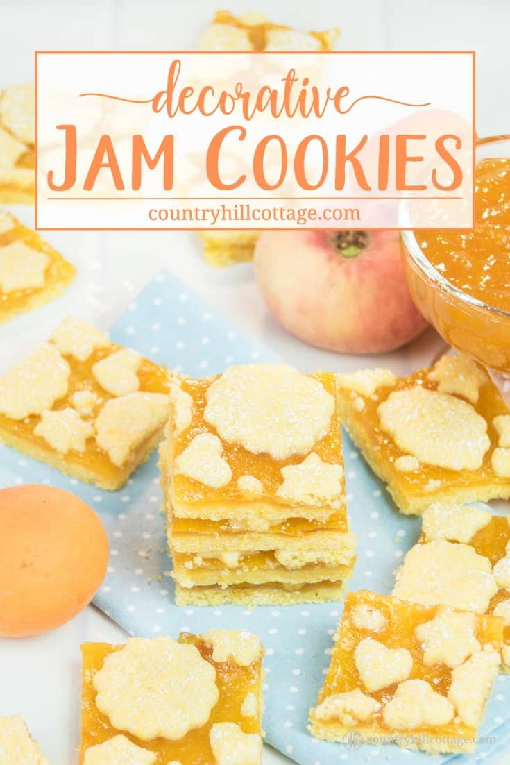These decorative jam biscuits taste super scrumptious and look pretty to give as food gifts. The cookie dough is made with all-purpose flour and maize flour (yellow cornmeal), which gives the biscuits their sunny colour and adds a nice, gritty texture. We used peach jam but other apricot jam or raspberry preserve a tasty alternatives. These jam biscuits make wonderful little presents. #cookies #biscuits #cookierecipe #holidaybaking |countryhillcottage.com