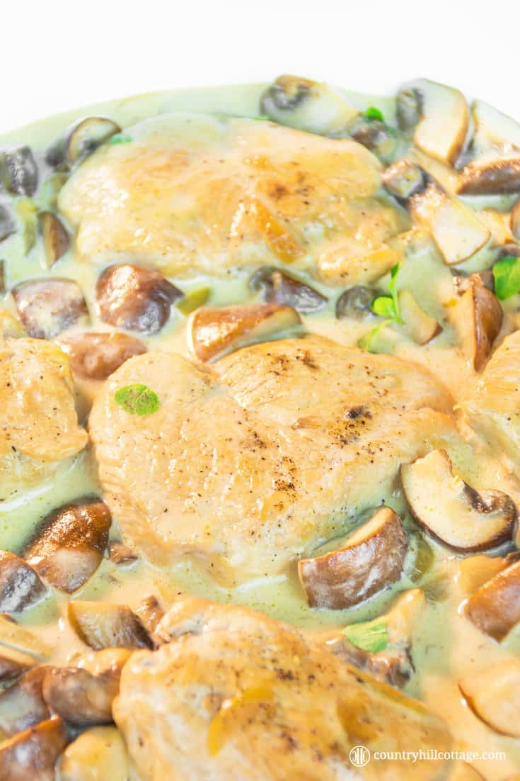 Turkey cutlets with mushrooms gravy are incredibly easy to make and done in under one hour. Button mushrooms, onions, and cream create a delicious gravy, which drenches the juicy cutlets rich, flavourful goodness. And as the turkey chops simmer in the tasty gravy, there's zero chance the meat dries out. You can prepare the recipe with both turkey and chicken cutlets. #turkey #mushrooms #gravy #mushroomgravy | countryhillcottage.com