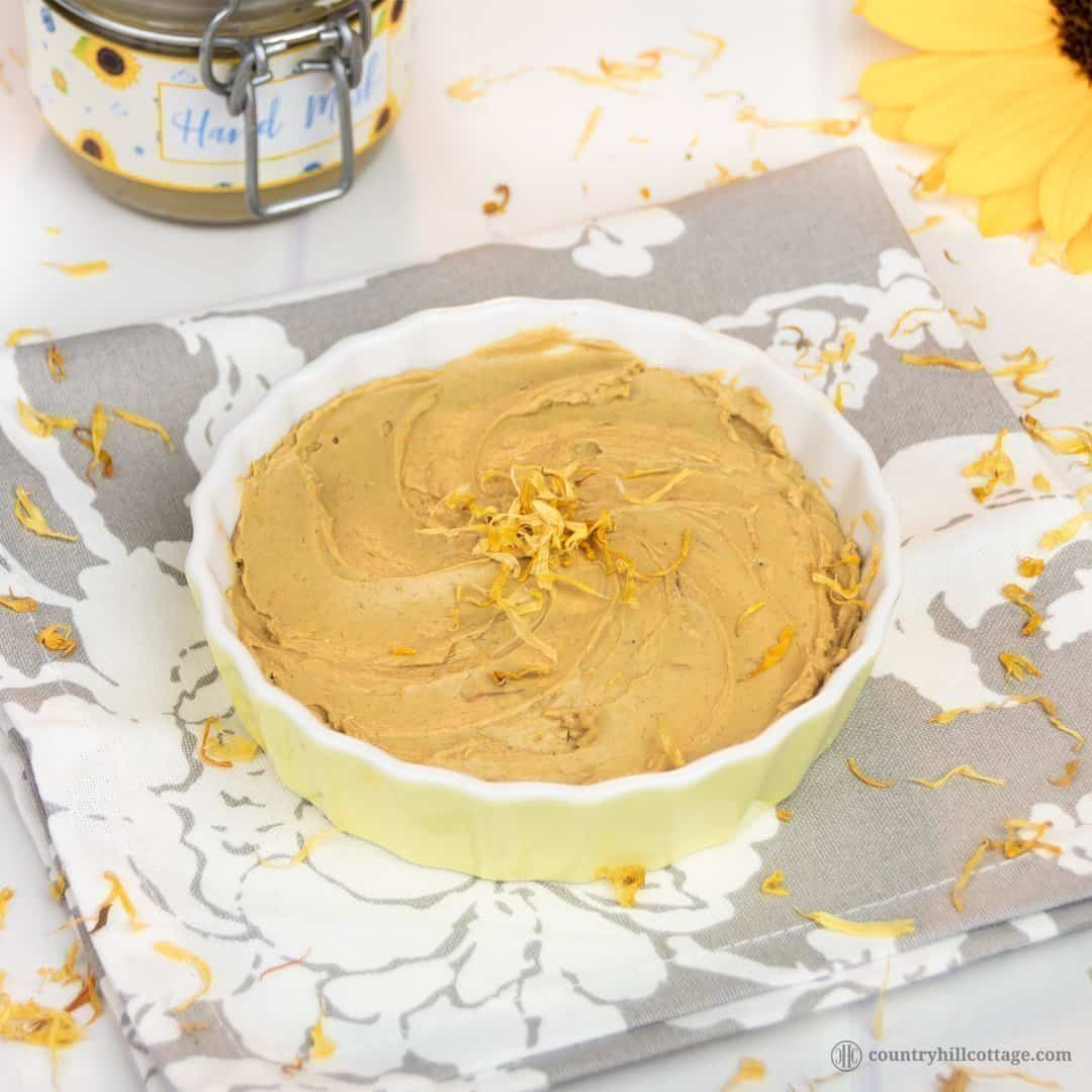 Care for your hands with a nourishing DIY hand mask! Our homemade clay mask clarifies and moisturises dry, sensitive skin. You only need 3 ingredients: French yellow clay, avocado and calendula oil, and optionally essential oils. This oil-based clay mask doesn't dry out the hands but moisturises and heals while cleaning the skin. The beauty DIY includes the printable recipe and printable labels for storing and gifting. #claymask #handmask #essentialoils #skincare   countryhillcottage.com
