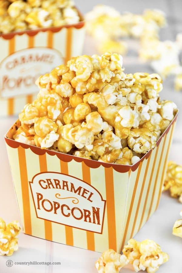 Homemade caramel popcorn is sweet, crunchy and hard to stop eating! This yummy snack is easy to whip up: pop the kernels or use premade popcorn. Then cook a thick caramel sauce with brown sugar and butter and toss the popcorn in the sauce. The recipe includes a printable retro popcorn box for gift giving or to serve at your next movie. Check out the recipe and learn how to make caramel popcorn from scratch. #caramelpopcorn #caramel #popcorn #foodgifts   countryhillcottage.com