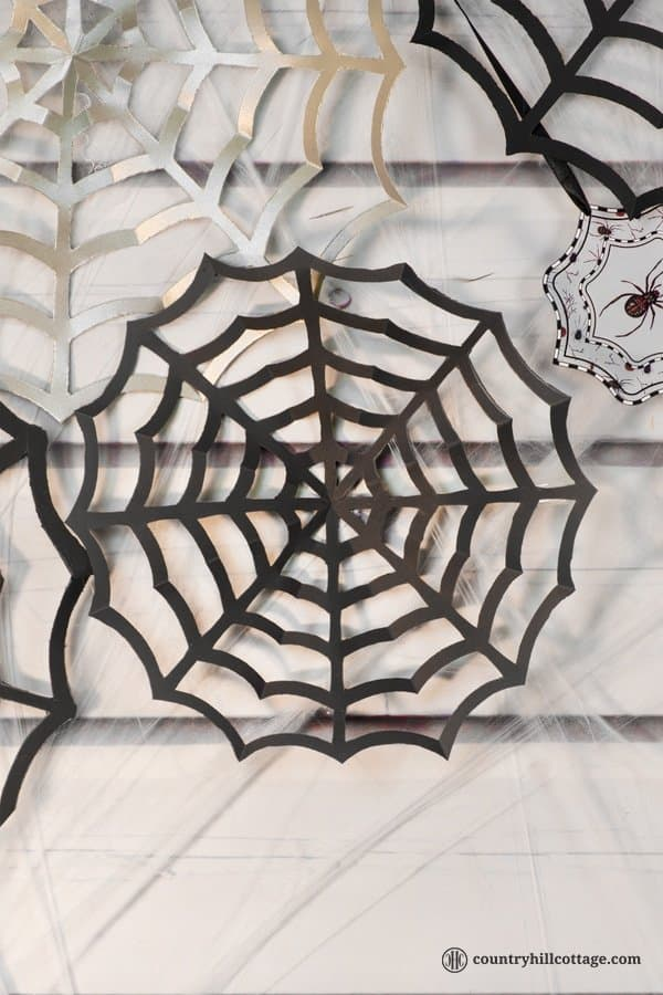 Paper spider webs add super spooky vibes to your home or classroom! DIY cobwebs look great as wall ornament, front door or window ornament, party décor and photo backdrop. All you need for this Halloween craft is paper, pencils, and craft scissors. This is a great DIY project to make with kids and an easy teacher Halloween craft for the classroom. Included are a free printable template and instructions. #DIY #spiderweb #Halloween #papercrafts | countryhillcottage.com