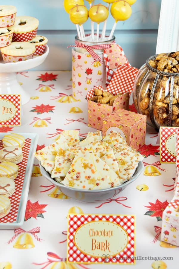 Christmas chocolate bark is a scrumptious sweet gift for anyone and great for holiday parties. This homemade holiday bark is totally doable in under one hour so that you can whip up a batch even last-minute. You don't have to be a candy expert to make this treat. Just melt, pour, and decorate away. Easy and perfect to make with kids. We made our Christmas bark with crytsalised ginger, candied nuts, and cute sprinkles. #chocolatebark #candybark #chocolate #foodgift | countryhillcottage.com
