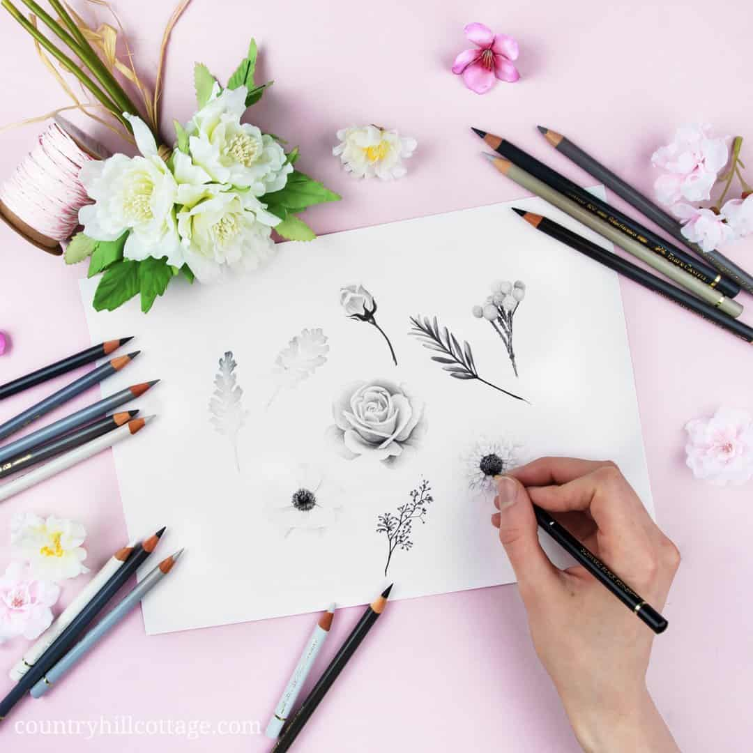 Our Chelsea Blooms print is based on a black and white drawing of roses, anemones and scabious flowers, eucalyptus berries, dusty miller leaves and silver brunia berries. Limiting the colour palette to white, blacks, and greys was very interesting and drives the attention to the details of design element and gives the design a fresh and botanical feel. #drawing #pencildrawing #flowerdrawing #flowers #florals | countryhillcottage.com