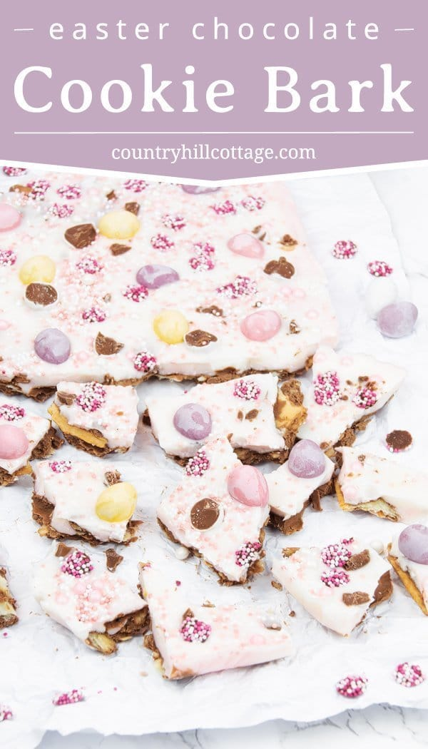 Every bite of this Easter chocolate cookie bark is a mouthful of yum flavour. A layer of milk chocolate mixed with crushed cookies is coated with white chocolate and topped with mini chocolate eggs and fun sprinkles. This easy and delicious chocolate bark recipe is the perfect combination of crunchy and sweet. The bark is a great DIY foodie gift for spring and an Easter basket stuffer that kids will love. #chocolate #chocolatebark #Easter #Eastertreat #foodgift| countryhillcottage.com
