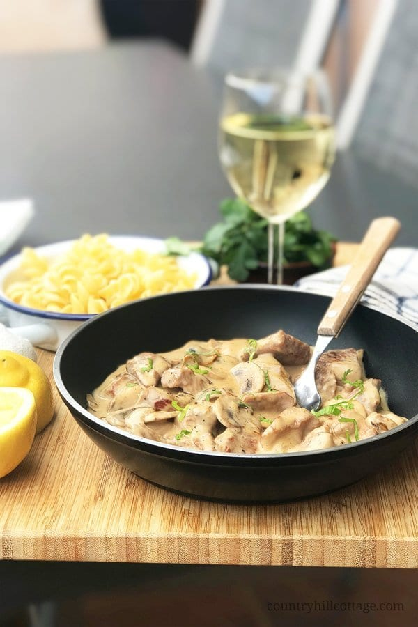 Chicken stroganoff is a quick and tasty dinner recipe. This meal is perfect for busy weeknights and when you crave a creamy, comforting chicken dish. The ingredients include chicken, mushrooms, cream, Worcestershire sauce and other pantry staples. Stroganoff can be served with pasta, bread, or boiled rice. #chicken #chickenstroganoff #stroganoff #dinner #chickenrecipe #comfortfood | countryhillcottage.com