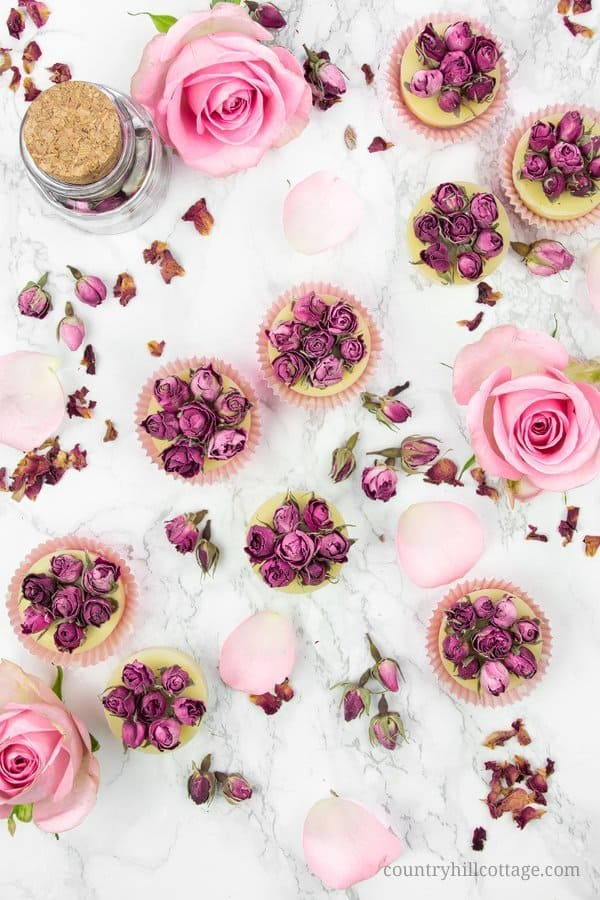 Soothe away in the tub with skin softening DIY rose bath truffles! Melting in a warm bath, this homemade beauty product infuses the water with nourishing oils and butters that moisturise your skin while you relax in the tub. The DIY beauty recipe is formulated with rosehip oil and fragrant rose essential oil. These bath melts are a relaxing addition to your bath time and great gift for natural beauty lovers! #bathtruffles #bathmelts #essentialoil #naturalskincare #rose| countryhillcottage.com