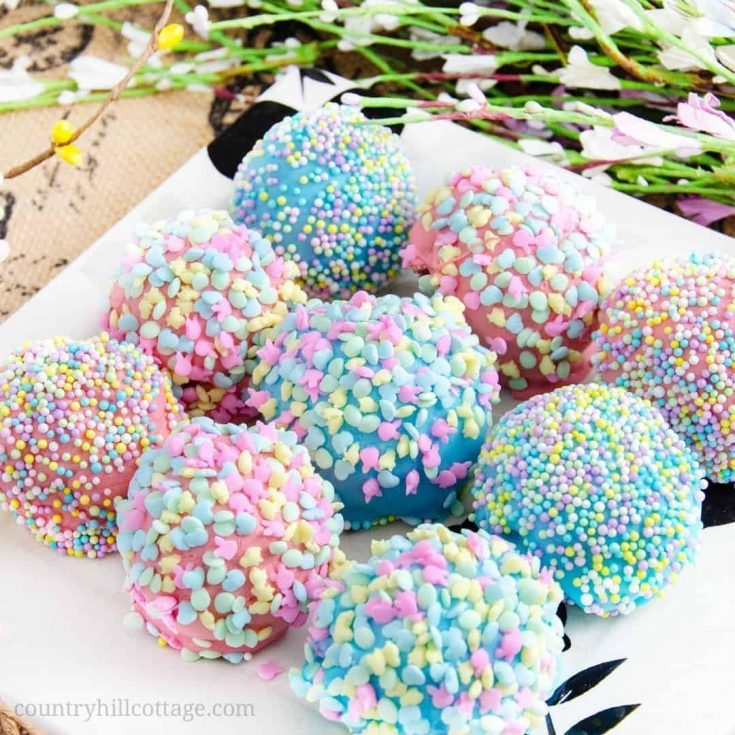 These sweet, delicious carrot cake bites are perfect Easter treats and basket stuffers with their bright colors and Easter sprinkles. The cake bites are easy to make. The recipe uses boxed cake mix, with adjustments to make it taste homemade, and a yum cinnamon cream cheese frosting. The bites are dipped in pastel candy melts and covered with sprinkles. Your friends and family will love this homemade food gift. #cakebites #Eastertreat #Easter #sprinkles #cakepops | countryhillcottage.com