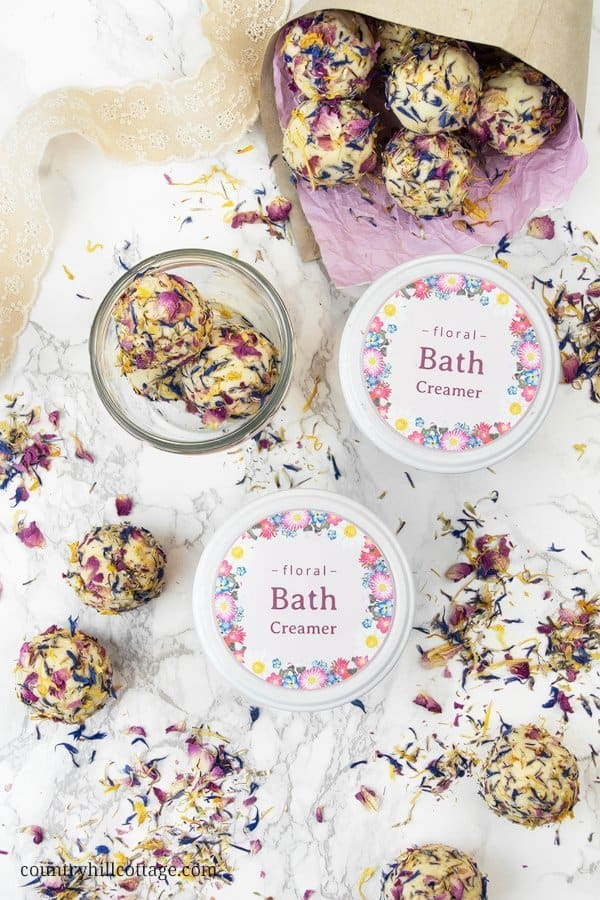 If you have ever looked for ways to moisturise and care for your skin, add these all-natural DIY bath creamers with essential oils into your bath. They dissolve in a fun fizz and enrich the water with soothing and nourishing ingredients that cater to your skin needs. The bath creamers release a lovely floral fragrance, allowing you to pamper yourself and enjoy a wonderful spa-at-home experience. #bathcreamer #bathbomb #bathmelt #essentialoils #naturalskincare | countryhillcottage.com