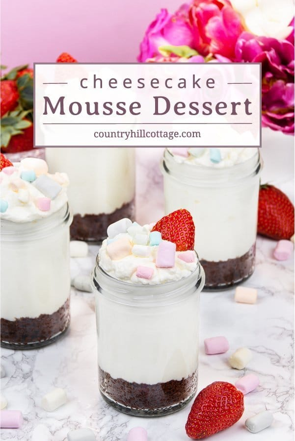 No-Bake Cheesecake Mousse Dessert Jars are made with a crunchy cookie crust, a creamy cheesecake mousse, and garnished with berries and mini marshmallows. It only takes a few minutes to prepare this cheesecake dessert and there are many ways to customise the recipe according to your taste or the season of the year. No-bake cheesecake mousse is perfect for many occasions can be served after dinner, at parties, and dessert tables. #nobake #cheesecake #mousse #dessert | countryhillcottage.com
