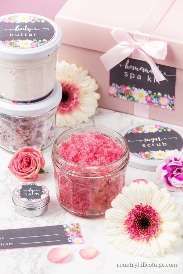 A DIY spa kit is perfect for a spa day at home and a lovely homemade gift idea for mom and friends. The quick beauty recipes are made with affordable ingredients and include: a whipped body butter with shea butter and coconut oil, a simple DIY vanilla sugar scrub recipe and an easy DIY Epsom bath salt with baking soda and essential oils. The beauty products are packaged in cute jars and come with free printable labels. #bodybutter #bathsalt #sugarscrub #essentialoils| countryhillcottage.com