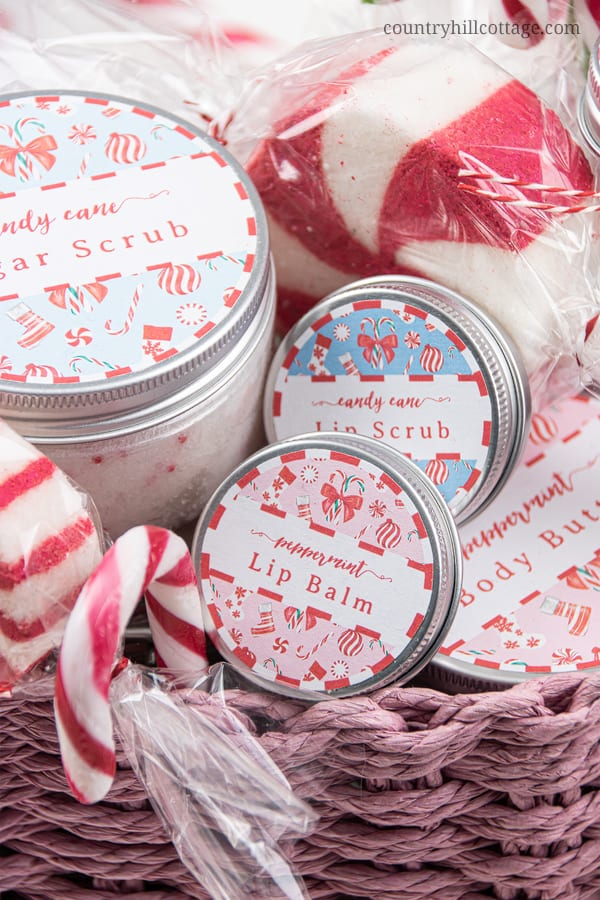 See how to make holiday spa gift set with homemade beauty gifts! This girly and cute candy cane themed relaxation gift box is an inexpensive DIY Christmas gift basket for women, girls, mom, teenagers, friends, teachers, coworkers, and neighbors. This easy relaxation gift basket idea is a unique, elegant present to pamper someone special. Includes gift wrapping ideas and free printables. #spagiftbasket #relaxationgiftbox #homemadespagiftbasket #giftbasket #Christmasgift | countryhillcottage.com