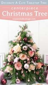 See how to make a Christmas tree centerpiece with pretty ornaments, real pine and fresh flowers! A mini DIY tabletop Christmas tree is an excellent holiday decoration for small spaces and a beautiful Christmas arrangement for a table, the kitchen, bedroom, living or dinning room. You learn display ideas and small Christmas tree decorating ideas for modern, vintage, rustic and Farmhouse. #TabletopChristmasTree #centerpiece #ChristmasTree #Christmasdecor #minitree | countryhillcottage.com