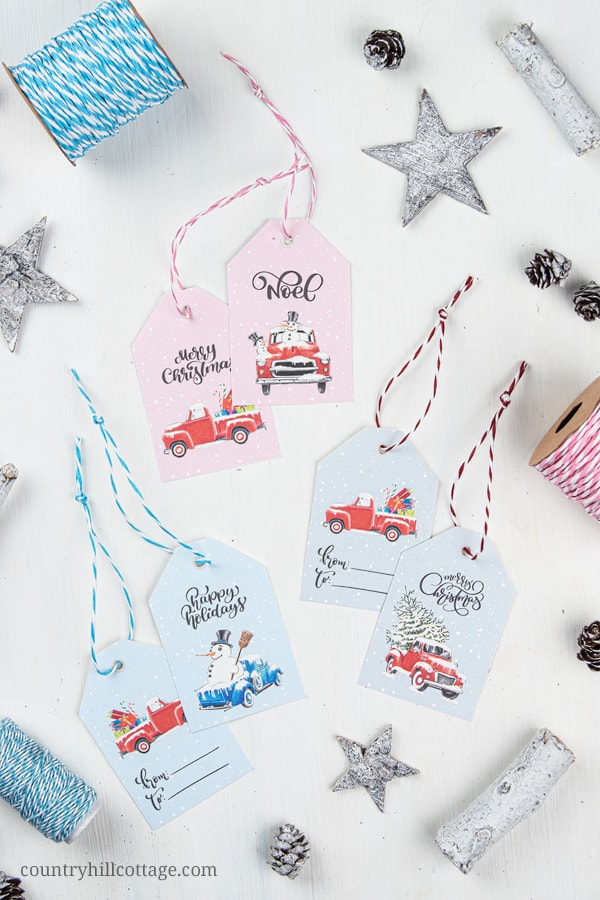 FREE printable Christmas truck gift tags! Chreate cute handmade holiday gift tags for Xmas gift giv-ing and holiday packaging. The prints are illustrated with vintage Christmas trucks and holiday deco-rations. The design is festive, a little rustic, creative, unique and farmhouse, perfect for friends and family. Included are 8 different designs and text messages, including to from tags. #gifttag #gifttags #printable #freeprintable #Christmas #holidays #Christmastruck | countryhillcottage.com