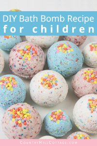DIY bath bombs without citric acid or cream of tartar are an easy homemade bath bomb recipe for kids. These bath bombs turn a boring bath time routine into a fun experience for girls and boys. Learn how to make and customise these simple 3-ingredient funfetti bath fizzies with sprinkles, colour, and natural organic essential oils that are safe for children. Lush inspired, great gift idea. Without cornstarch, without Epsom salt, no citric acid. #bathbombs #essentialoils | countryhillcottage.com