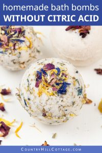 DIY bath bombs without citric acid or cream of tartar are an easy homemade bath bomb recipe for sensitive skin and women who are pregnant or breastfeeding. Learn how to make and customise these simple 3-ingredient bath fizzies with dried flowers and natural organic essential oils. Lush inspired, great gift idea. Without cornstarch, without Epsom salt, no citric acid. #bathbombs #essentialoils #bathbombrecipe #skincare #bathfizzies #greenbeauty | countryhillcottage.com