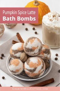 Learn how to make a simple natural DIY bath bomb recipes without cornstarch! Pretty pumpkin spice latte bath bombs have a lovely scent & create cozy fall vibes while you relax in the tub. These easy homemade bath bombs with essential oils are very fizzy & made with moisturizing ingredients that hydrate your skin while you enjoy the aromatherapy benefits. Perfect for kids & a great holiday gift idea for Halloween & Christmas. #bathbombs #aromatherapy #fall #pumpkinspicelatte | countryhillcottage.com