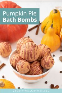 Learn how to make a simple natural DIY bath bomb recipes without cornstarch! Pretty pumpkin pie bath bombs have a lovely scent & create cozy fall vibes while you relax in the tub. These easy homemade bath bombs with essential oils are very fizzy & made with moisturizing ingredients that hydrate your skin while you enjoy the aromatherapy benefits. Perfect for kids & a great holiday gift idea for Halloween & Christmas. #bathbombs #aromatherapy #fall #autumn #pumpkinpie | countryhillcottage.com