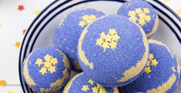 DIY foaming bath bombs with shea butter help to relax and promote a good night's sleep. Calm your mind, relieve stress, and create a spa-worthy bath ritual to unwind. Homemade foaming bath fizzies add fizz and bubbles to the water and turn bath time into a fun excitement for kids and adults. Shea butter leaves the skin well nourished and moisturized. Essential oils immerse the senses and relaxes mind and body. #bathbombs #essentialoils #aromatherapy #sheabutter #beautydiy  countryhillcottage.com