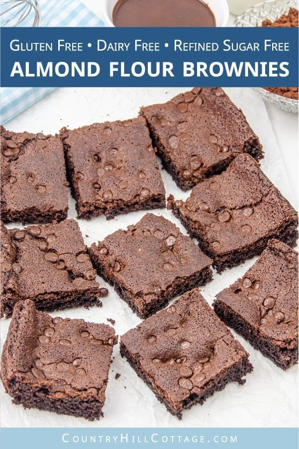 Chewy, fudgy, gooey gluten free almond flour brownies melt in your mouth and taste super chocolatey. These quick flourless, low carb, grain free, dairy free, refined sugar free and paleo friendly brownies have a crispy crust and moist inside. This simple healthy homemade brownie recipe without flour is perfect for kids and an easy gluten free dessert for a crowd + party. Made with coconut oil and cocoa powder. Can be made eggless and vegan. #brownies #paleo #glutenfree | countryhillcottage.com